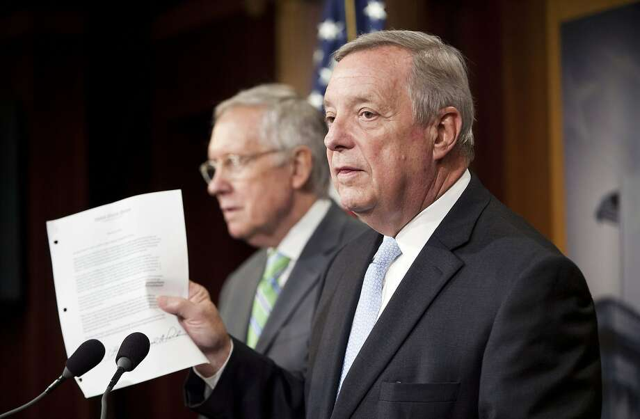 Sen. Dick Durbin (right) holds up a copy of a letter sent to Iran's leader by Senate Republicans. Photo: Pablo Martinez Monsivais, Associated Press