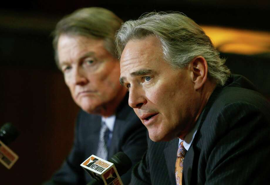 In this Dec. 15, 2013, file photo, University of Texas athletic director Steve Patterson, right, and school president Bill Powers discuss a search for a new head football coach during an NCAA college football news conference in Austin, Texas. A person with direct knowledge of the decision says Texas athletic director Steve Patterson has been fired. The person spoke Tuesday, Sept. 15, 2015, on condition of anonymity because the school had not announced the move. Photo: Jack Plunkett /Associated Press / FR59553 AP