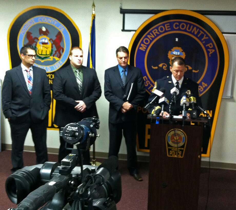 Pennsylvania law enforcement officials discuss plans to arrest 37 in the death of a freshman from a New York City college. Photo: Andrew Scott, Associated Press