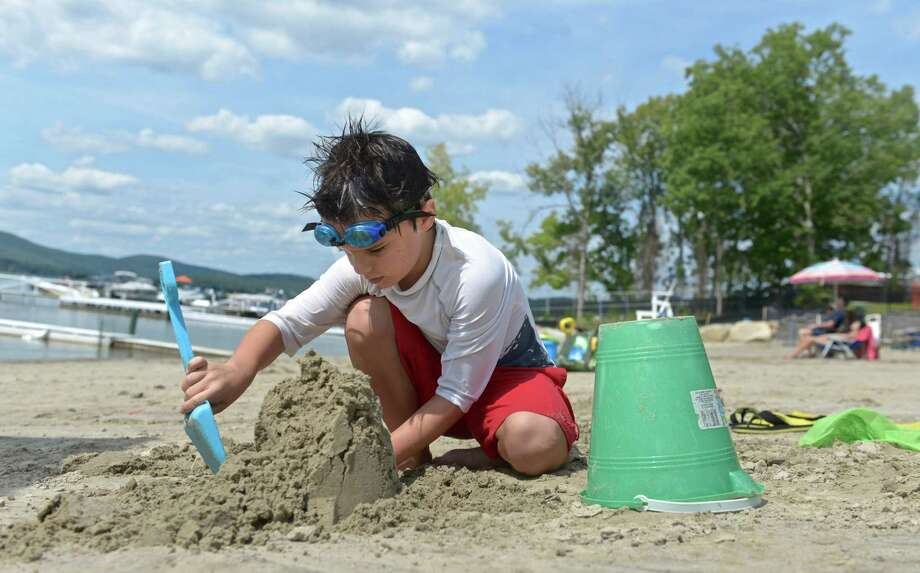 Ryan McKeever, 8, of Brookfield, builds a sand castle while at the Brookfield Town Park beach with his family on Saturday, August 29, 2015, in Brookfield, Conn. Photo: H John Voorhees III / Hearst Connecticut Media / The News-Times