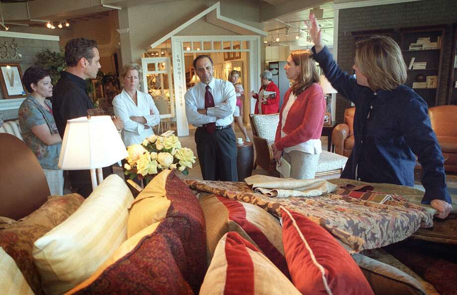 Farooq Kathwari, chairman and ceo of Ethan Allen Interiors discusses store displays with store designers and managers in the company's flagship Danbury store Thursday