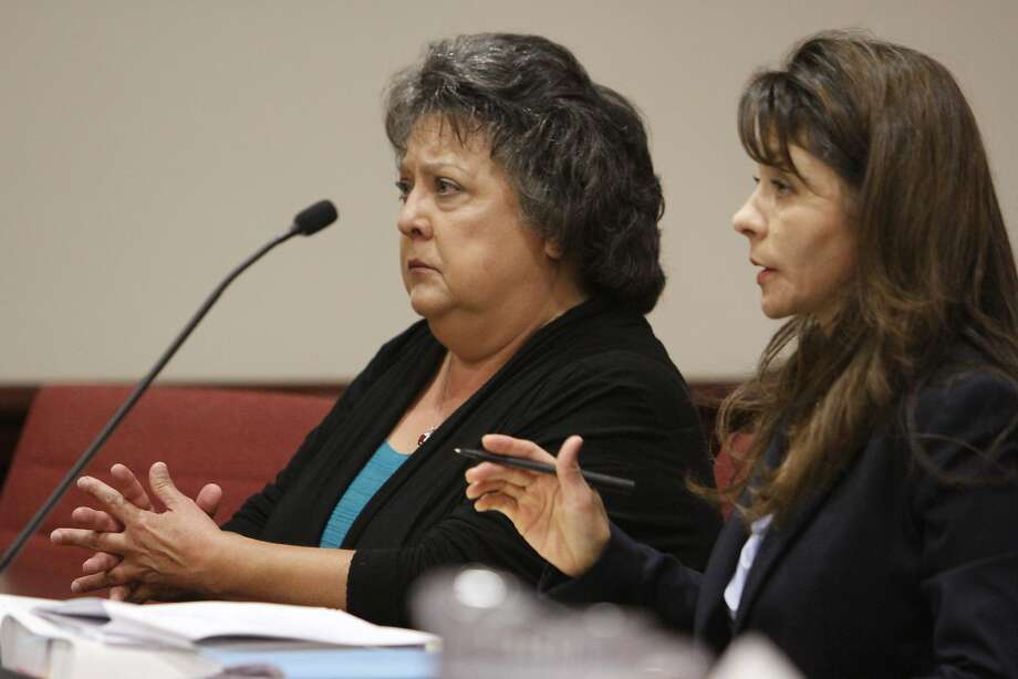New Mexico Secretary of State Dianna Duran (left) sits in a Santa Fe court with her attorney, Erlinda Johnson. Duran pleaded not guilty to fraud, embezzlement and other charges after being accused of funneling campaign contributions to her personal bank accounts and withdrawing large sums of money at casinos around the state. Photo: Luis Sanchez Saturno, Associated Press