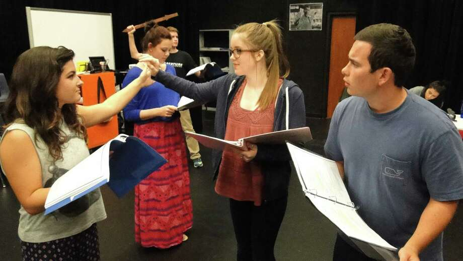 "Ensemble member Hannah Smith, left, Jillian Grisko as Dorothy and Grant Gammon as the scarecrow work on scene development.  Seven Lakes High School theater company's first production of the school year is ""The Wizard of Oz."" Photo: Kaycee Swierc / Seven Lakes"