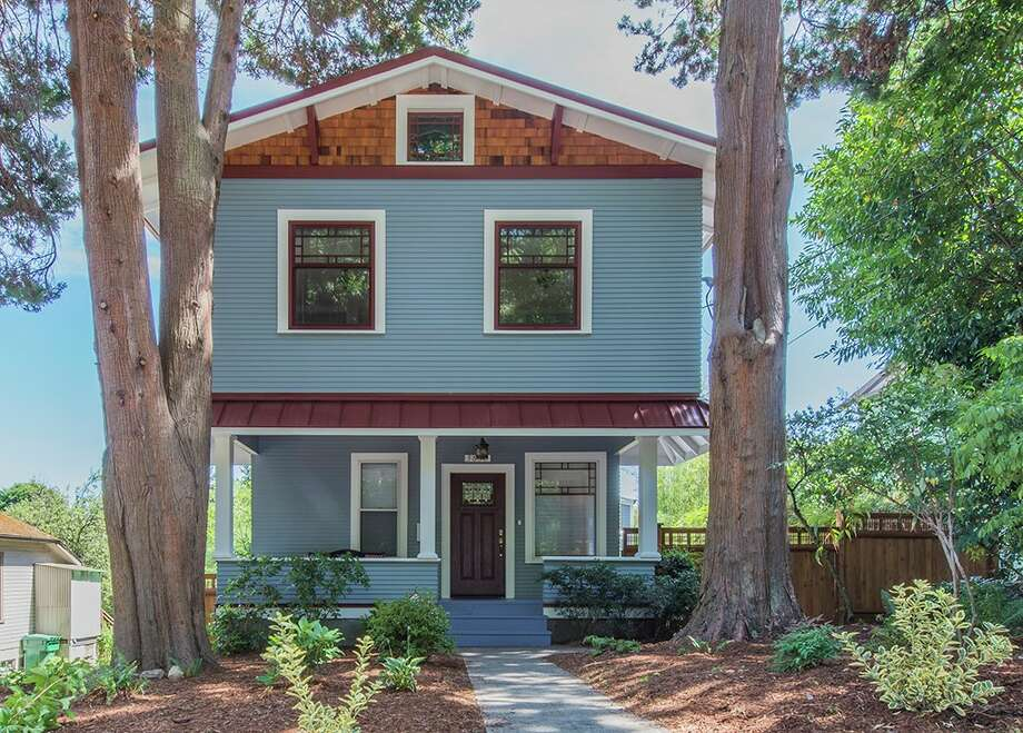 First we give you 3836 36th Ave. W. in Magnolia. The four-bedroom, 2.5-bathroom home is listed at $880,000.The house was built in 1910, but it's been extensively remodeled, complete with a new addition finished in June 2015. The hardwood floors are the refinished originals. In addition to the two above-ground levels, there's also an unfinished basement. Photo: Jonathan Park, Erena Rombakh, Windermere Real Estate / Jonathan Park