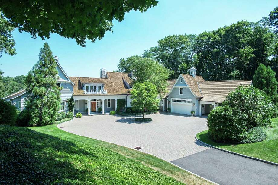 This home is on four acres at the edge of Five Mile River in New Canaan. Photo: Contributed / Contributed Photo / New Canaan News