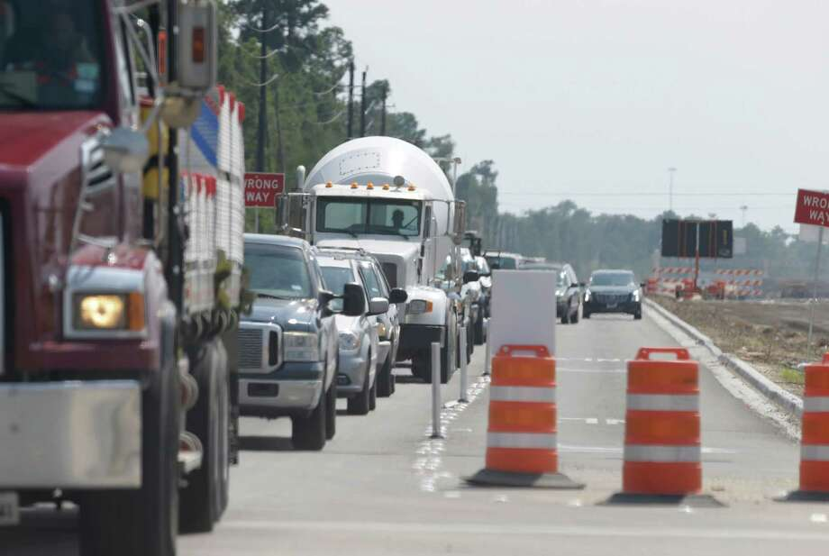 Work on the Grand Parkway has caused headaches for motorists along Riley Fuzzel Road near the intersection of Rayford Road with ongoing lane closures, confusing signs, poorly timed signals and dozens of large construction vehicles on the roads. Photo: Melissa Phillip, Staff / © 2015 Houston Chronicle
