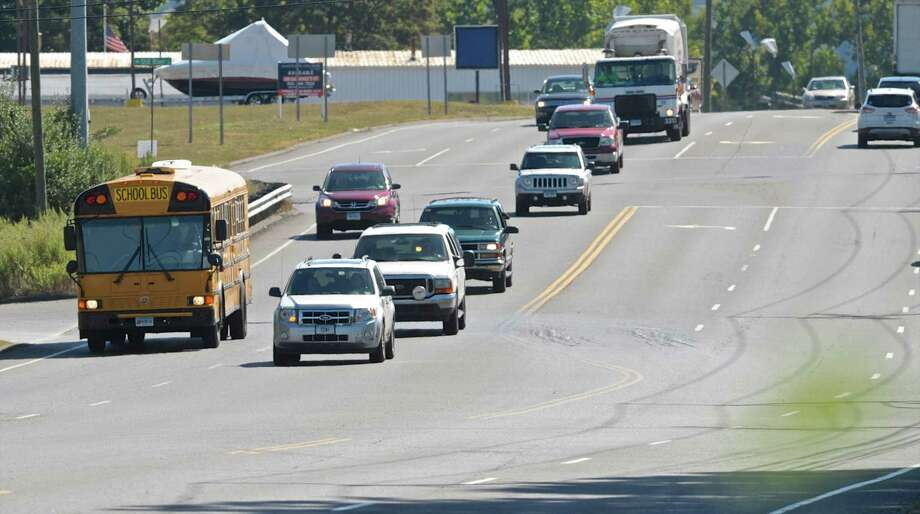 A New Milford school bus drives it's route on Danbury Road on Tuesday afternoon. The New Milford Police have given out 442 tickets to drivers passing stopped school buses onDanbury Road since the spring. September 15, 2015, in New Milford, Conn. Photo: H John Voorhees III / Hearst Connecticut Media / The News-Times