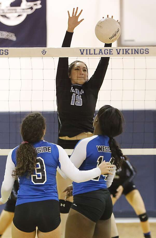 Elisa Flores of the Village School sucessfully blocks a shot by Westside as the two teams faced off on September 4, 2015. Photo: Diana L. Porter, Freelance / © Diana L. Porter