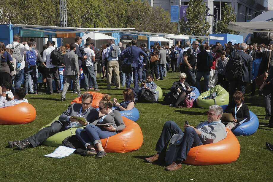Attendees take a break on the bean bag chairs along Howard St. as Dreamforce gets underway at the Moscone Center in downtown San Francisco, Calif.,  on Tues. September 15, 2015. Photo: Michael Macor, The Chronicle