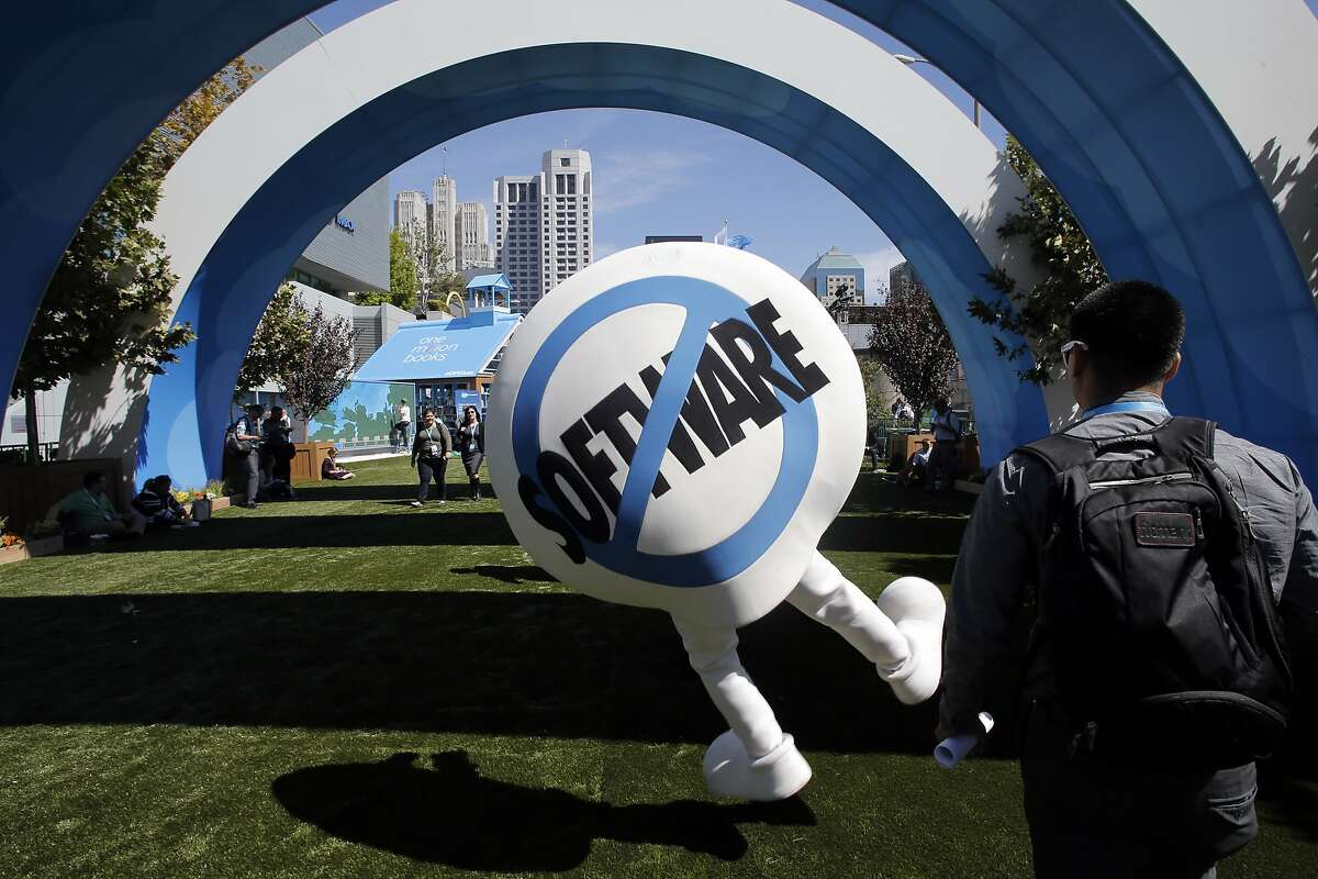 """Salesforce mascot """"Sassy"""" enters the center with a heel click, as Dreamforce gets underway at the Moscone Center in downtown San Francisco, Calif., on Tues. September 15, 2015."""