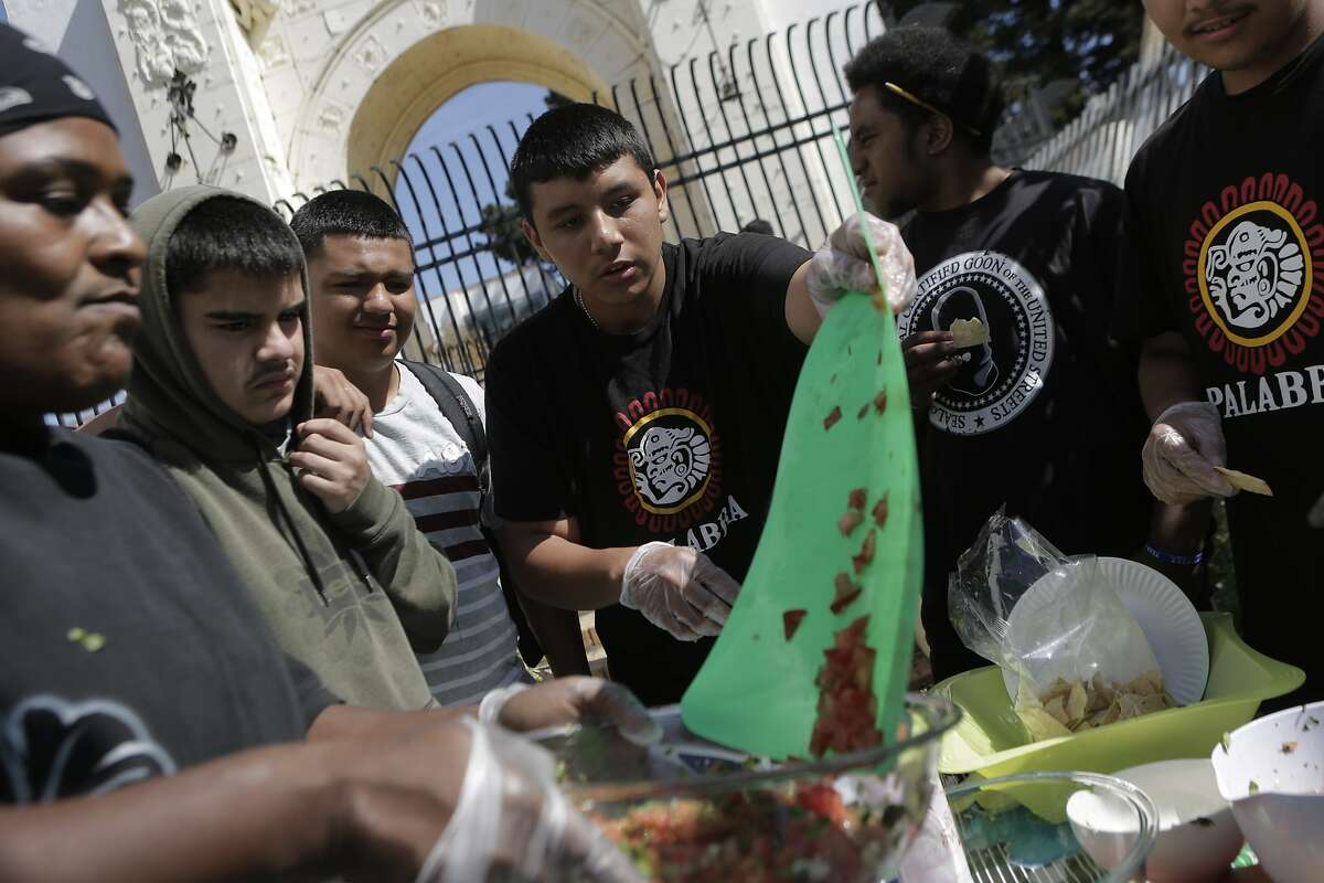 Students and members of the Latino Men and Boys program make fresh Pico de Gallo during class at Fremont High School in Oakland, Ca. on Tuesday, September 15, 2015. The Latino Men and Boys program is a new initiative to focus on Latino males in the school district.