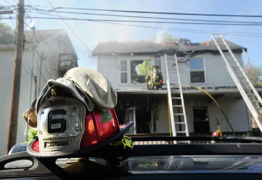Stamford firefighters battling a blaze at a home on Limerick Street in May in this file photo. Photo: Bob Luckey / Bob Luckey / Greenwich Time