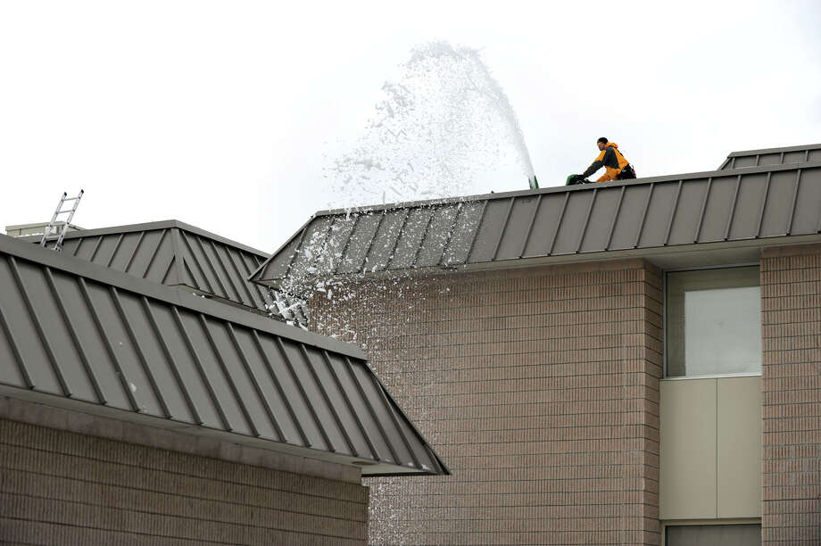 Joe Quaranta of Roxbury using a snowblower to remove snow from the roof of at Schaghticoke Middle School in New Milford Tuesday, February 8, 2011. Photo: Carol Kaliff / ST / The News-Times