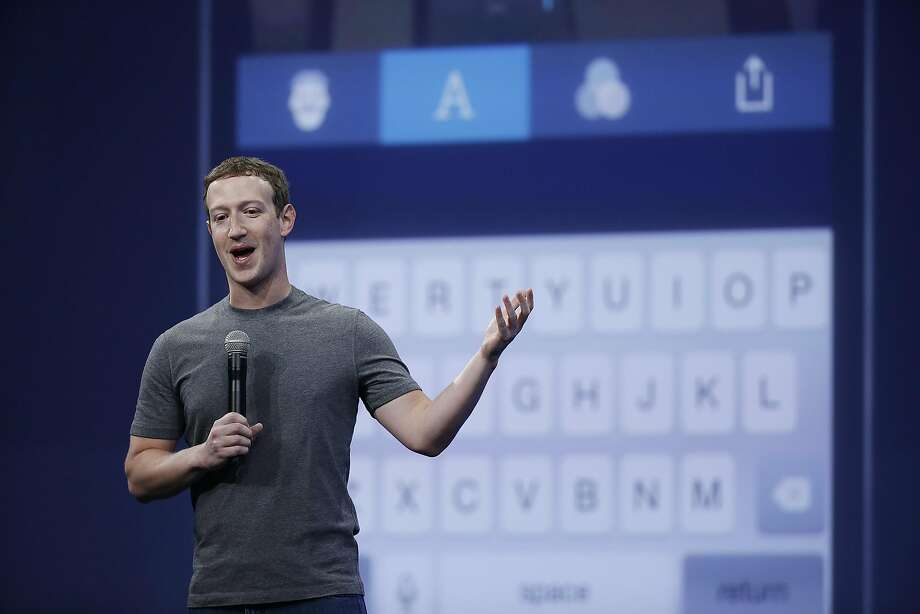 FILE - In this March 25, 2015 file photo, Mark Zuckerberg talks about the Messenger app during the Facebook F8 Developer Conference in San Francisco.  For the first time, a billion people used Facebook in a single day on Monday, Aug. 24, 2015. Zuckerberg marked the occasion with a post on his Facebook page, saying that one out of seven people on Earth logged in to the social network to connect with their friends and family. (AP Photo/Eric Risberg) Photo: Eric Risberg, Associated Press