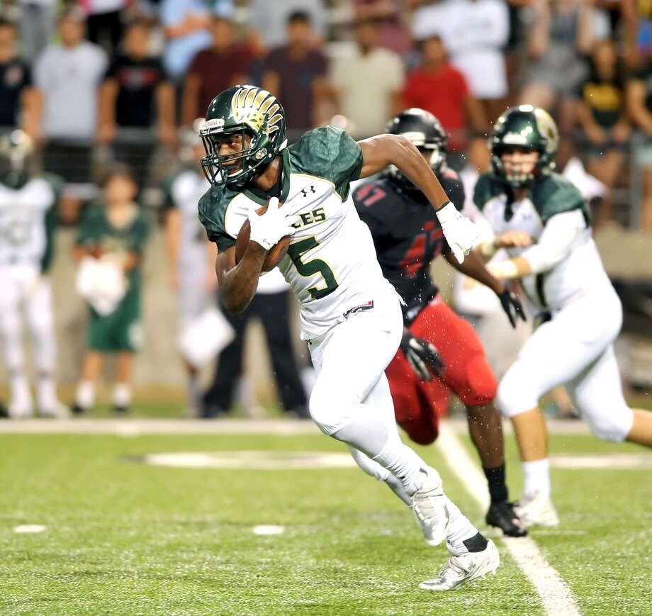 Cy Falls running back Shannon Vaughns was stellar against the Langham Creek defense in the Golden Eagles' 33-30 win last week. Photo: Eddy Matchette, Freelance / Freelance