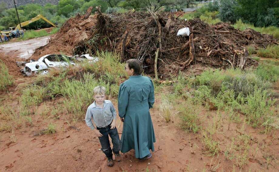"At least nine people were killed Tuesday in a flash flood that has been called a ""100-year event"" and the worst flood in memory for residents of Utah and Arizona. Photo: Rick Bowmer, STF / AP"