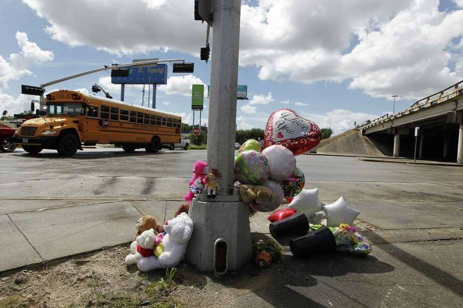Two students died and two others were hurt along with their bus driver on Sept, 15, when a collision caused a school bus to plunge from Loop 610, officials said. The bus landed on the eastbound frontage road of Loop 610 near Telephone Road. Photo: Steve Gonzales, Houston Chronicle / © 2015 Houston Chronicle