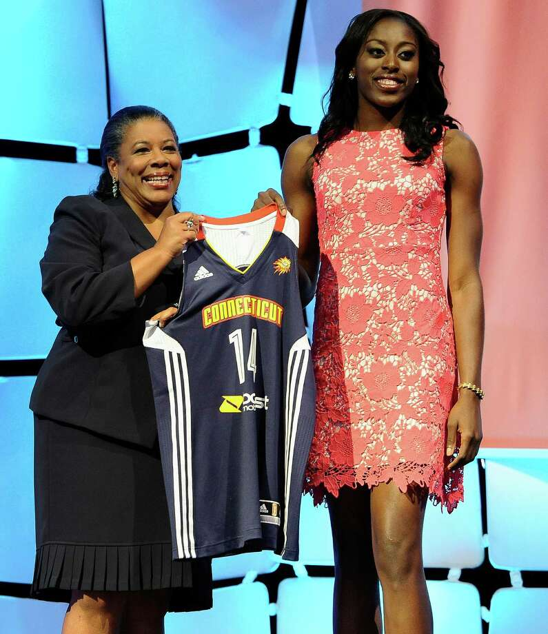 WNBA president Laurel Richie with Chiney Ogwumike, the Connecticut Sun's top pick in the 2014 WNBA draft. On September 15, 2015, Stamford, Conn.-based Synchrony Financial named Richie to an initial slate of board observers with the expectation of voting them directors when Synchrony separates from General Electric in late 2015. (AP Photo/Jessica Hill) Photo: Jessica Hill / AP / Associated Press