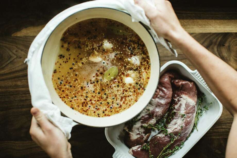 After the pork rests for 24 hours in this cider brine, it will be perfect for the grill. Photo: Julie Soefer / Boyte Creative