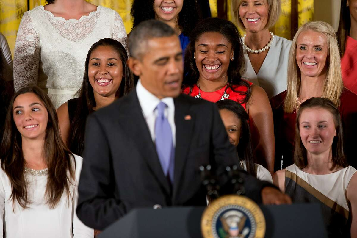 Team member react as President Barack Obama speaks in the East Room of the White House in Washington, Tuesday, Sept. 15, 2015, during a ceremony honoring the 2015 NCAA Women's Basketball Champion University of Connecticut Huskies. (AP Photo/Andrew Harnik)