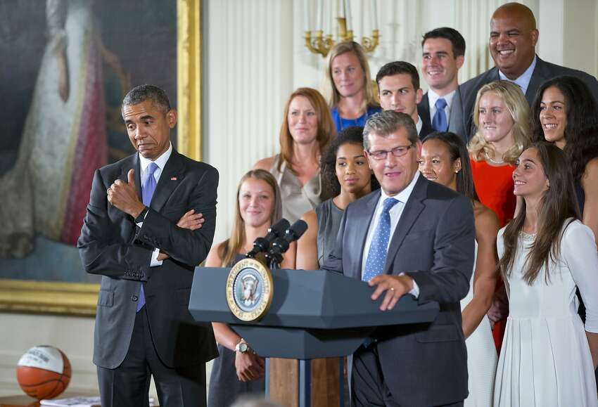 President Barack Obama gives a 'thumbs-up' as he reacts to remarks made by UConn Huskies Women's basketball head coach Geno Auriemma, Tuesday, Sept. 15, 2015, in the East Room of the White House in Washington during a ceremony where the president honored the NCAA Champion UConn Huskies Women's Basketball. (AP Photo/Pablo Martinez Monsivais)