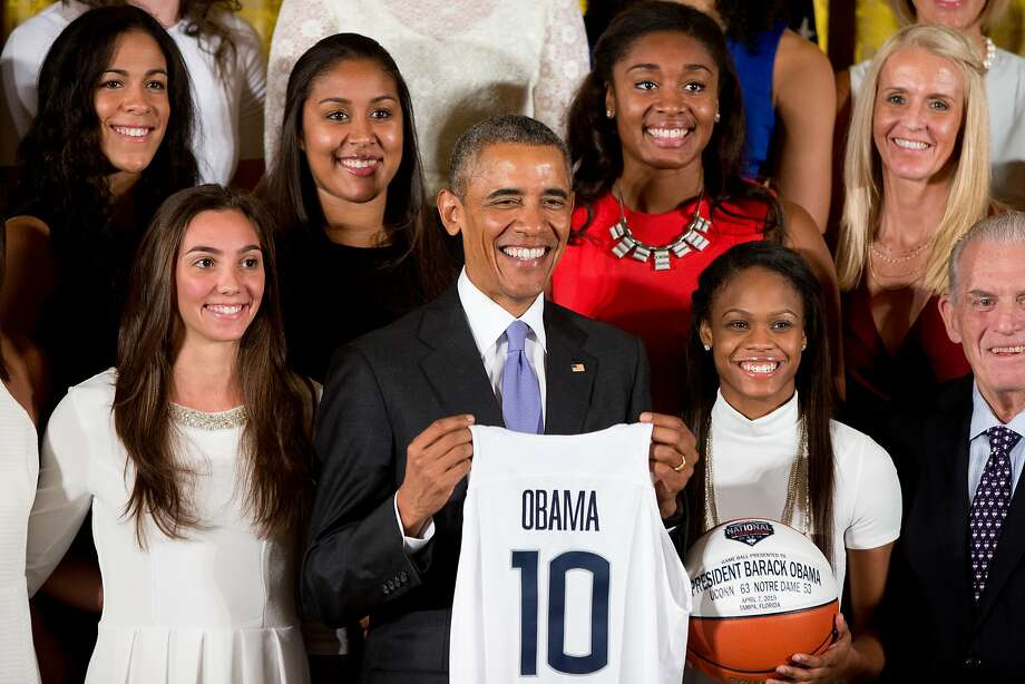 President Barack Obama poses for a group photograph in the East Room of the White House in Washington, Tuesday, Sept. 15, 2015, during a ceremony honoring the 2015 NCAA Women's Basketball Champion University of Connecticut Huskies. (AP Photo/Andrew Harnik) Photo: Andrew Harnik, Associated Press