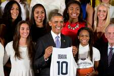 President Barack Obama poses for a group photograph in the East Room of the White House in Washington, Tuesday, Sept. 15, 2015, during a ceremony honoring the 2015 NCAA Women's Basketball Champion University of Connecticut Huskies. (AP Photo/Andrew Harnik)
