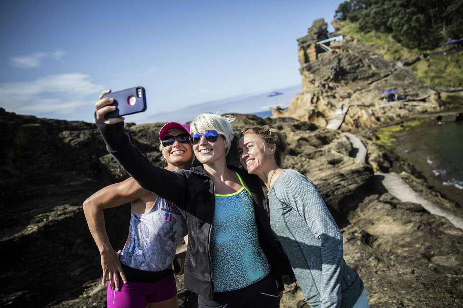 Selfies on the cliff edges can be perilous. So far this year, 12 people have reportedly died while taking selfies. Photo: Handout, Getty Images / 2015 Red Bull