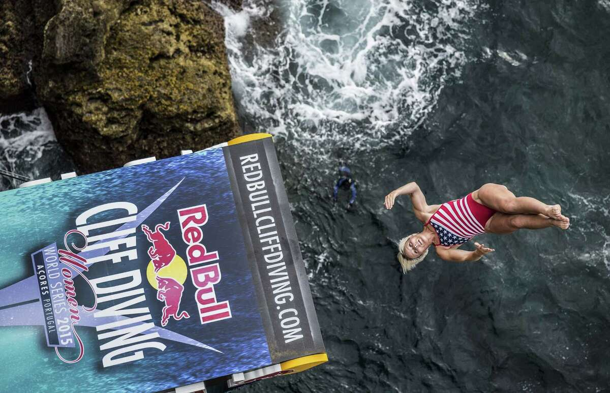 In this handout image provided by Red Bull, Rachelle Simpson of the USA dives from the 20 meter platform during the fifth stop of the Red Bull Cliff Diving World Series on July 18, 2015 in Islet Franca do Campo, Azores, Portugal.