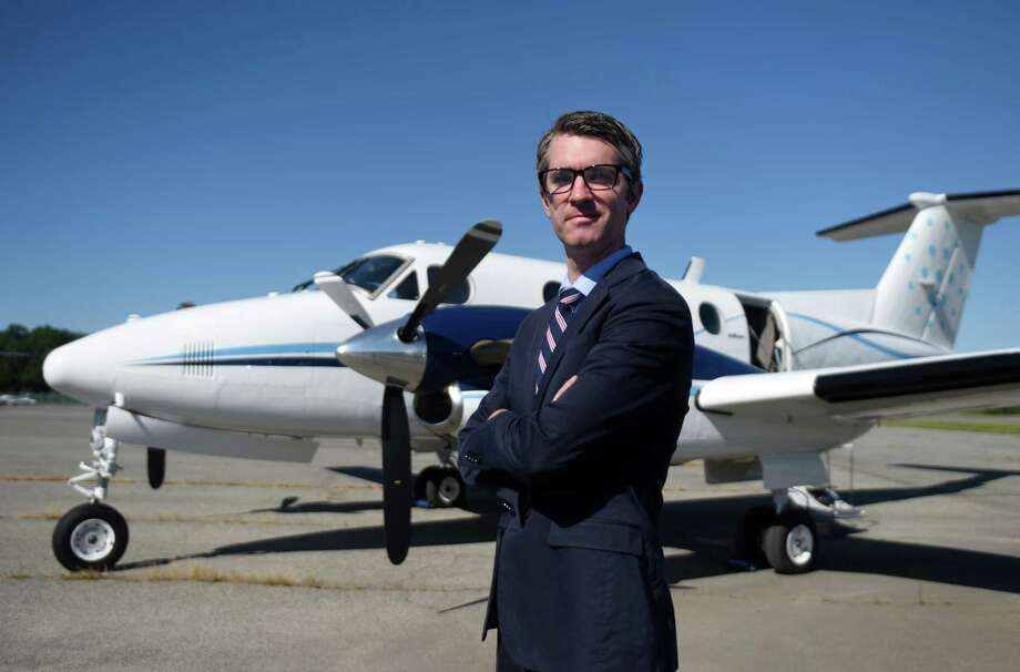 Beacon CEO Wade Eyerly stands in front of one of the planes as it prepares for takeoff in its inaugural flight at Westchester County Airport in White Plains, N.Y. Tuesday, Sept. 15, 2015. Beacon provides an all-you-can-fly deal with unlimited flights between Westchester and Boston and seasonal flights to the Hamptons and Nantucket. The service's monthly price is $2,000 for a personal membership with additional members for $1,250. Photo: Tyler Sizemore / Hearst Connecticut Media / Greenwich Time