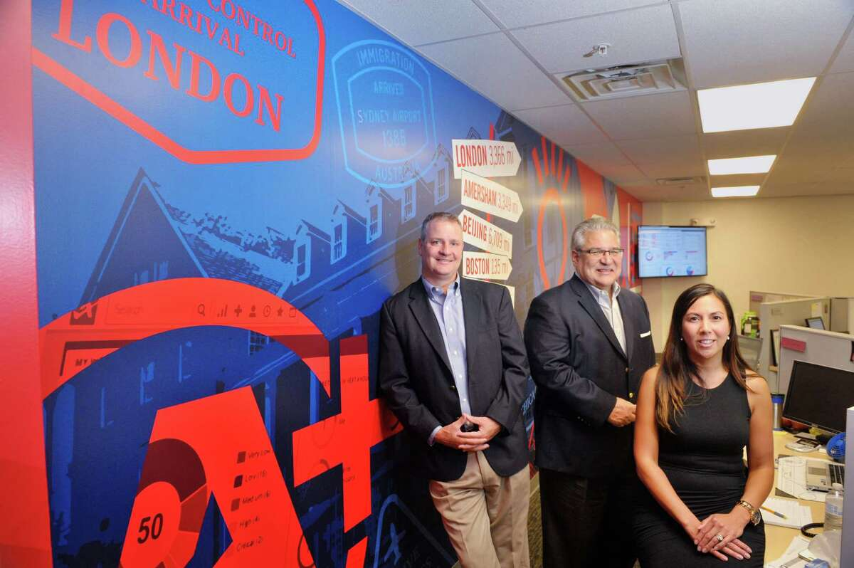Kevin Donovan, left, senior vice president of global sales at Autotask, Gary Martini, center, vice president of sales for Americas and Josette Valenti, vice president of human resources, pose for a photo in the newly expanded office space at the company on Monday, Sept. 15, 2015, in East Greenbush, N.Y. Autotask held an event Tuesday to show off their new expansion. (Paul Buckowski / Times Union)