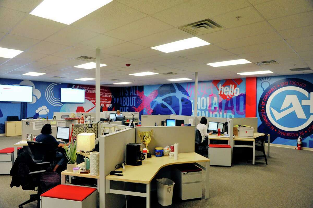 Employees in the client services department talk with their clients at Autotask on Monday, Sept. 15, 2015, in East Greenbush, N.Y. Autotask held an event Tuesday to show off their new expansion. (Paul Buckowski / Times Union)