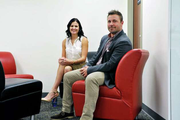 Lily Grenci, left, an account executive at Autotask and Andrew Negus, director of east coast sales, pose for a photo on Monday, Sept. 15, 2015, in East Greenbush, N.Y.  Autotask held an event Tuesday to show off their new expansion. (Paul Buckowski / Times Union) Photo: PAUL BUCKOWSKI / 00033367A
