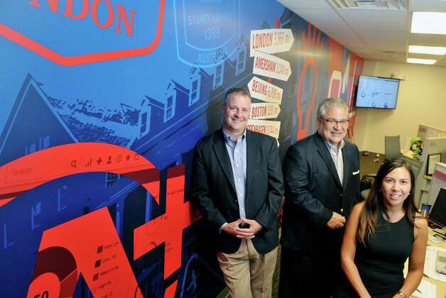 Kevin Donovan, left, senior vice president of global sales at Autotask, Gary Martini, center, vice president of sales for Americas and Josette Valenti, vice president of human resources, pose for a photo in the newly expanded office space at the company on Monday, Sept. 15, 2015, in East Greenbush, N.Y.  Autotask held an event Tuesday to show off their new expansion. (Paul Buckowski / Times Union) Photo: PAUL BUCKOWSKI / 00033367A