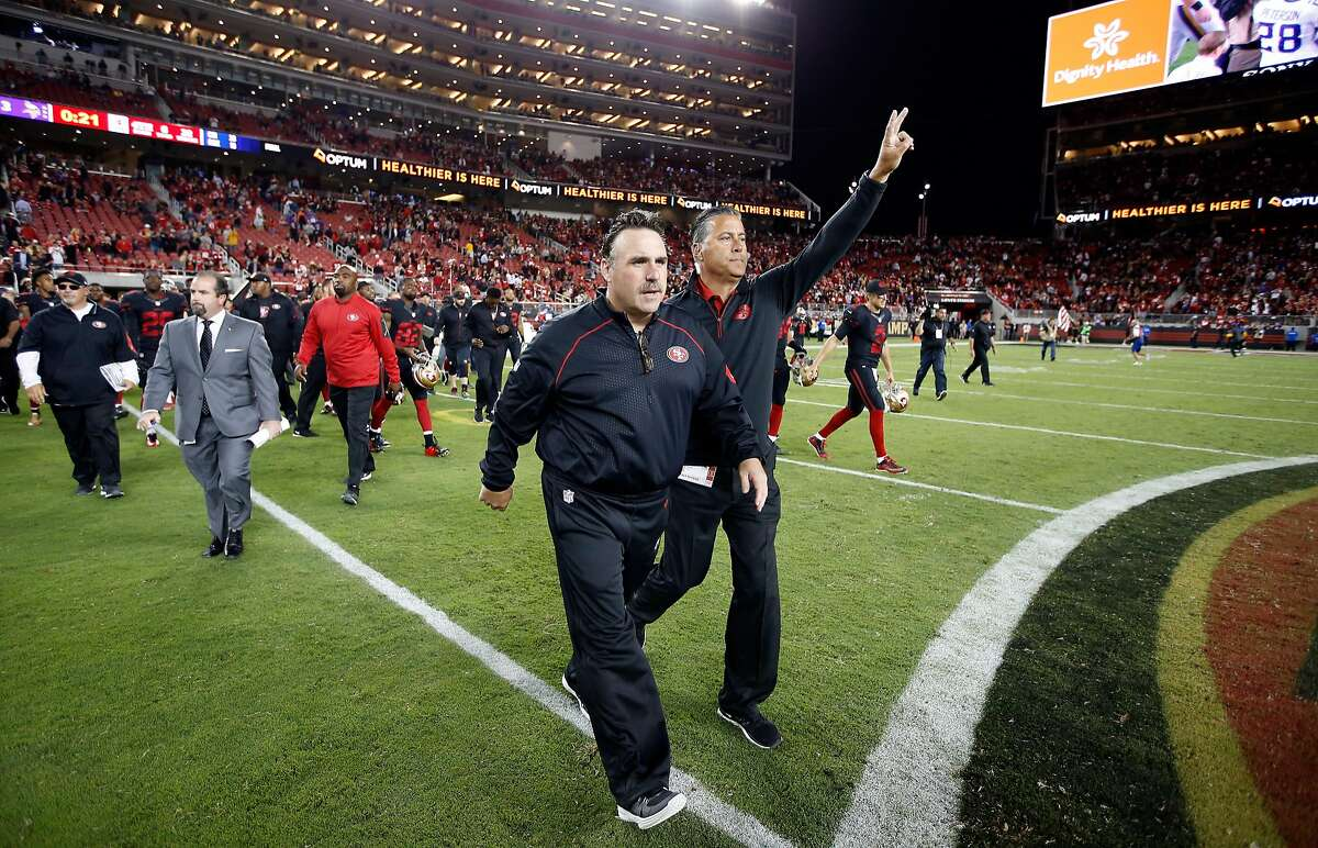 SANTA CLARA, CA - SEPTEMBER 14: Head coach Jim Tomsula of the San Francisco 49ers walks onto the field to shake hands after they beat the Minnesota Vikings in their NFL game at Levi's Stadium on September 14, 2015 in Santa Clara, California. (Photo by Ezra Shaw/Getty Images)
