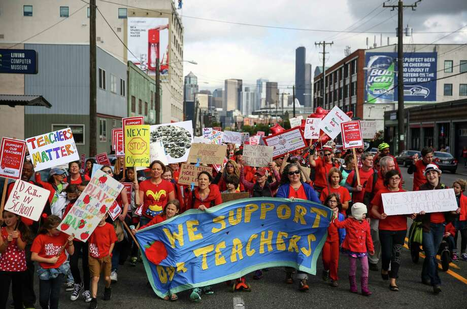 Students and parents march to Seattle Public Schools headquarters for a rally as a tentative agreement was announced between Seattle Public Schools and the Seattle Education Association that would end a strike by Seattle Public Schools teachers. Photographed on Tuesday September 15, 2015. Photo: JOSHUA TRUJILLO, SEATTLEPI.COM / SEATTLEPI.COM