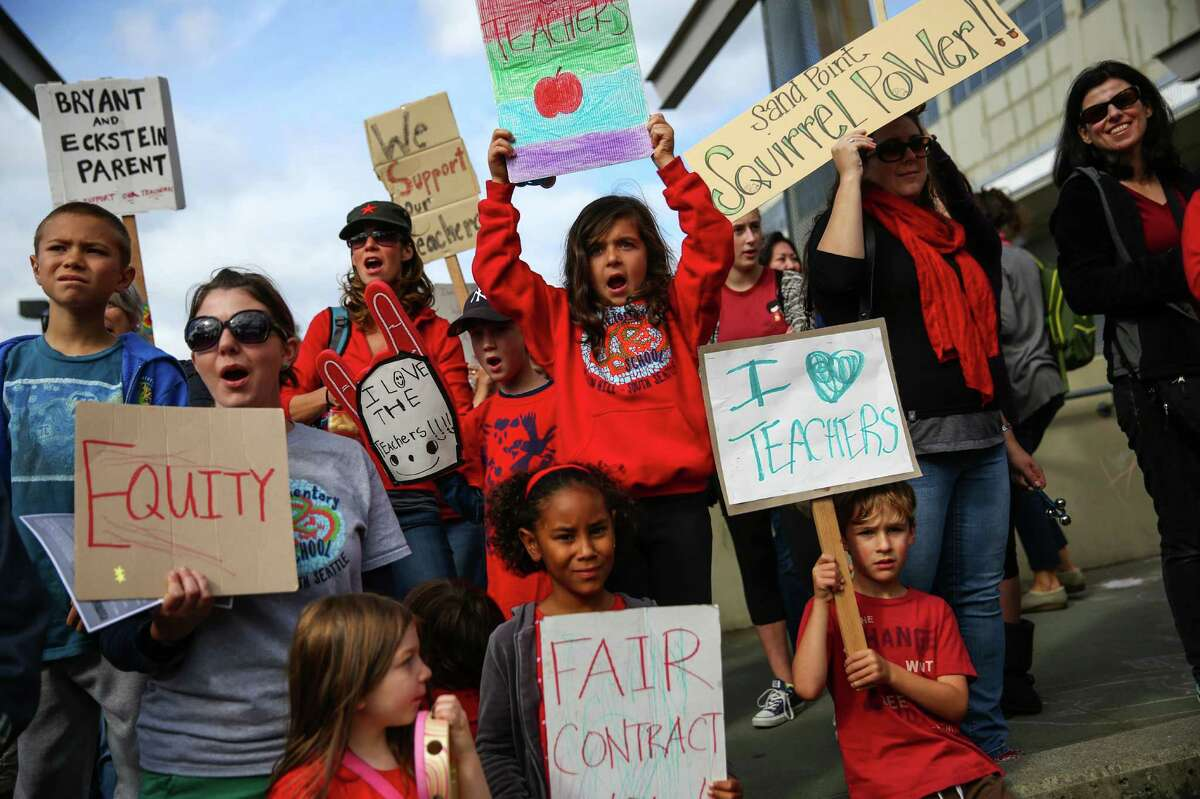 Students and parents gather at Seattle Public Schools headquarters for a rally as a tentative agreement was announced between Seattle Public Schools and the Seattle Education Association that would end a strike by Seattle Public Schools teachers. Photographed on Tuesday September 15, 2015.