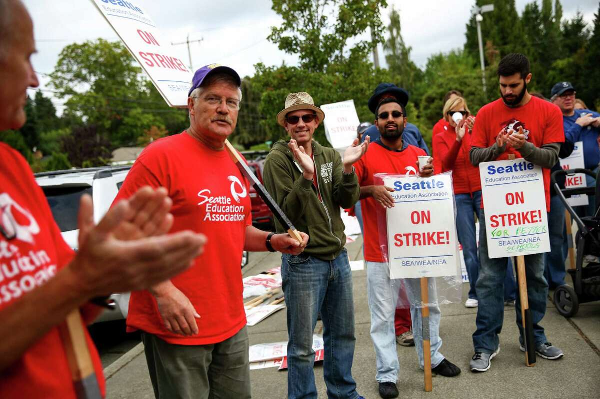 Doug Edelstein, a history teacher at Nathan Hale High School and member of the board of directors of the Seattle Education Association, speaks to striking teachers on the picket line outside the northeast Seattle high school after a tentative agreement was announced between Seattle Public Schools and the Seattle Education Association, possibly ending the teachers' strike. Photographed on Tuesday September 15, 2015.