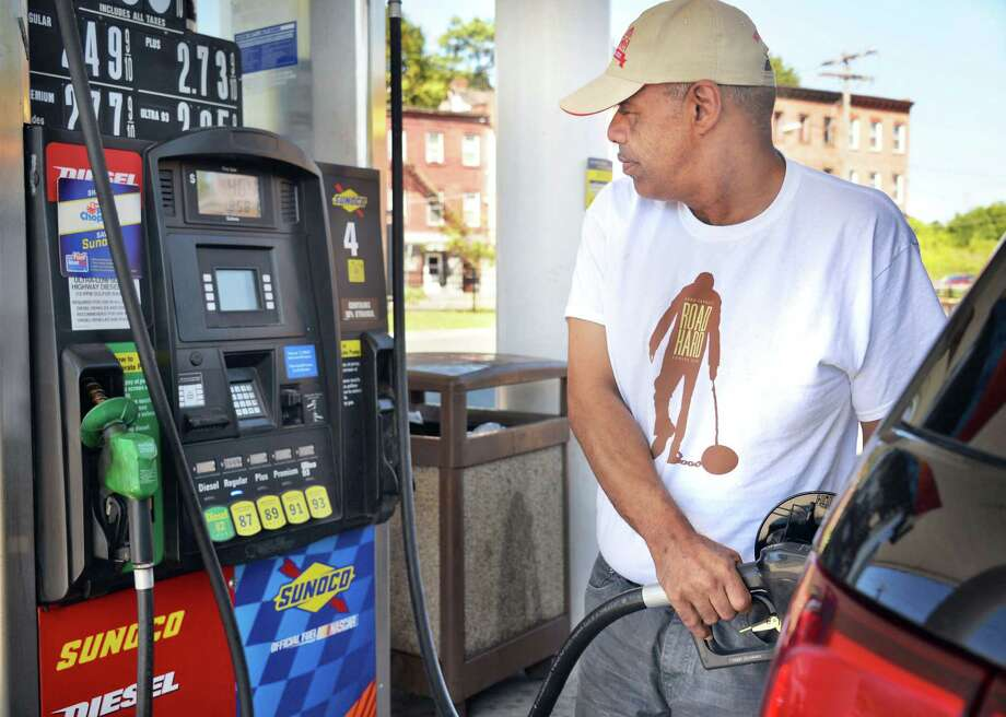 Lester Perkins of Albany pumps gas at the Broadway Sunoco station Tuesday Sept. 15, 2015 in Albany, NY. The cost of a gallon of regular unleaded gasoline continues to drop locally and nationally, according to the latest AAA Fuel Gauge report.  (John Carl D'Annibale / Times Union) Photo: John Carl D'Annibale / 00033371A
