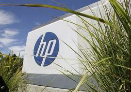 FILE - This Aug. 21, 2012 file photo shows an exterior view of Hewlett-Packard Co. headquarters in Palo Alto, Calif. Hewlett-Packard's upcoming spin-off of its technology divisions focused on software, consulting and data analysis will eliminate up to 30,000 jobs, the company announced Tuesday, Sept. 15, 2015. (AP Photo/Paul Sakuma, File)