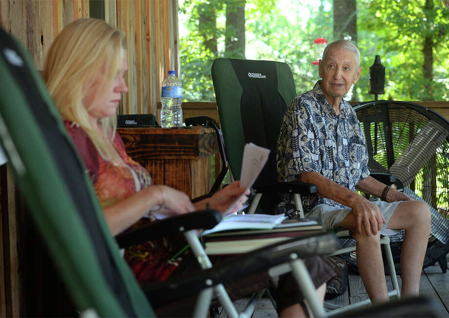 Angie Griggs, left, sifts through documentation and photos of Denis Griggs, right, at their Beaumont home on Monday. Griggs a former Navy man and school principal is diagnosed with pancreatic cancer and says he was denied appetite stimulant medication from the Veteran's Affairs office. Griggs said he has lost more than 40 pounds and that his prescribed medicine is an appetite stimulant. Photo taken Monday, September 14, 2015 Guiseppe Barranco/The Enterprise Photo: Guiseppe Barranco, Photo Editor