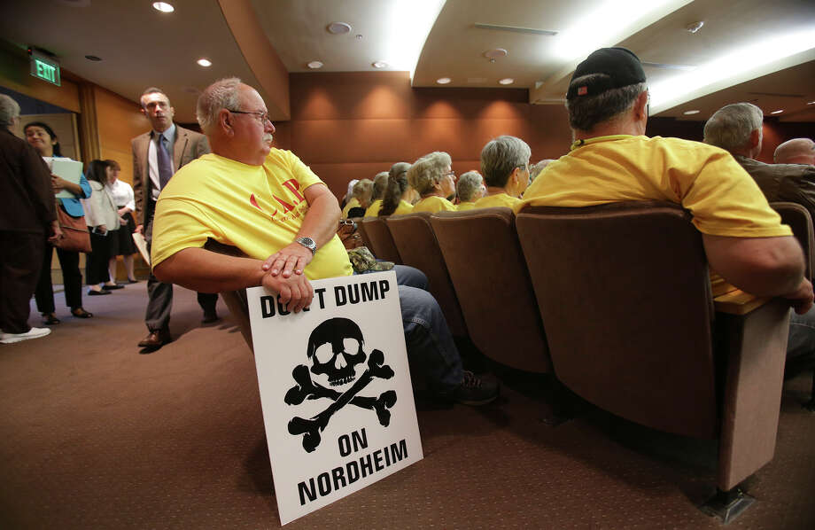 Rodney Karnei on Tuesday sits prepared to display his sign as the Texas Railroad Commission hears additional testimony concerning the application for an oil field waste facility to be located near Nordheim. Photo: Tom Reel