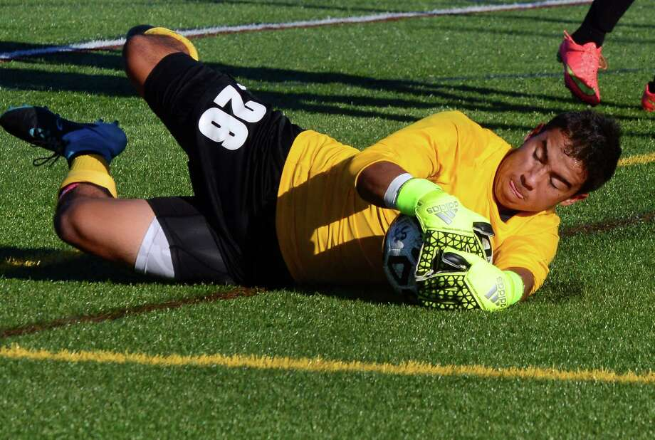 Trumbull goalie Jonathan Campbell stops the ball, during high school soccer action against St. Joseph in Trumbull, Conn. on Tuesday Sept. 15, 2015. Photo: Christian Abraham / Hearst Connecticut Media / Connecticut Post
