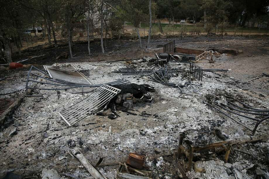 Two horses lie dead in a burned down structure in Hidden Valley Lake, California, on Tuesday, Sept. 15, 2015. Photo: Connor Radnovich, The Chronicle