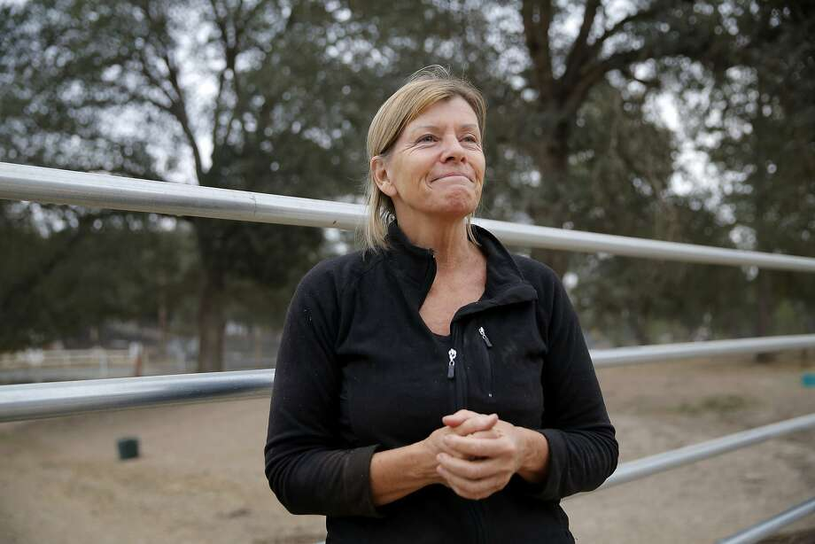 Cheryl Johnston, a Hidden Valley Lake resident, reflects on Saturday night and the Valley Fire at a ranch in Hidden Valley Lake, California, on Tuesday, Sept. 15, 2015. Johnston saved several horses, fought spot fires and eventually stayed overnight in a barn Saturday night as the Valley Fire spread. Photo: Connor Radnovich, The Chronicle