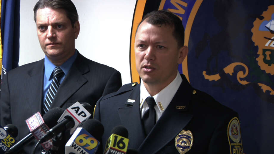 "In this image from video, Pocono Regional Police Chief Chris Wagner, right, and Monroe County Assistant District Attorney Michael Rakaczewski hold a news conference at the police station in Pocono Summit, Pa., on Tuesday, Sept. 15, 2015, to discuss charges in the hazing death of New York City college student Chun ""Michael"" Deng. A panel recommended third-degree murder charges against the Pi Delta Psi fraternity and five students at Baruch College in the Dec. 8, 2013, death of Chun ""Michael"" Deng. Thirty-two others face charges ranging from aggravated assault to hazing, Pocono Mountain Regional Police said in a statement. (AP Photo/Michael Rubinkam) ORG XMIT: PX101 Photo: Michael Rubinkam / AP"