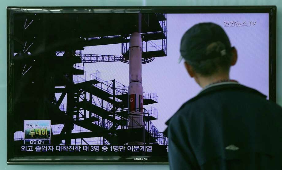 A South Korean man watches TV news program showing a file footage of the Unha rocket in North Korea, at Seoul Railway Station in Seoul, South Korea, Tuesday, Sept. 15, 2015. North Korea said Monday it is ready to launch satellites aboard long-range rockets to mark a key national anniversary next month, a move expected to rekindle animosities with its rivals South Korea and the United States. (AP Photo/ahn Young-joon) ORG XMIT: SEL101 Photo: Ahn Young-joon / AP