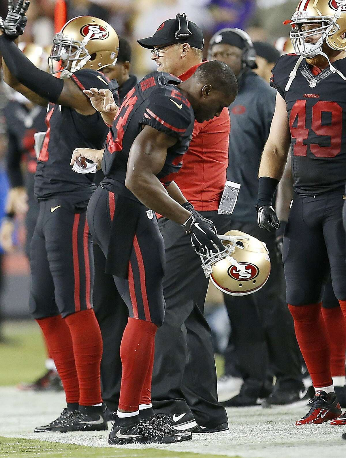 San Francisco 49ers running back Reggie Bush walks to the sideline during the first half of an NFL football game against the Minnesota Vikings in Santa Clara, Calif., Monday, Sept. 14, 2015. Bush was injured on a play and didn't return. (AP Photo/Tony Avelar)
