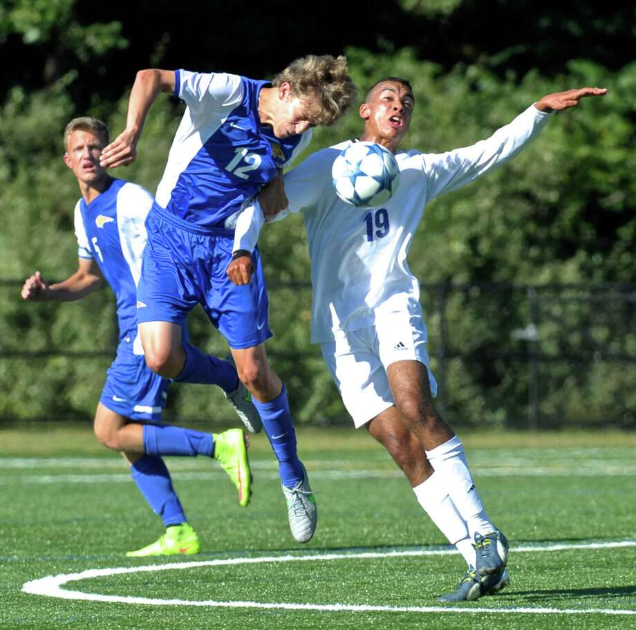 Brookfield's Matthew Williams (12) and Newtown's Josua Houle (19) fight for the ball during the boys high school soccer game between Brookfield and Newtown high schools, on Tuesday afternoon, September 15, 2015, at Treadwell Memorial Park, Newtown, Conn. Photo: H John Voorhees III / Hearst Connecticut Media / The News-Times