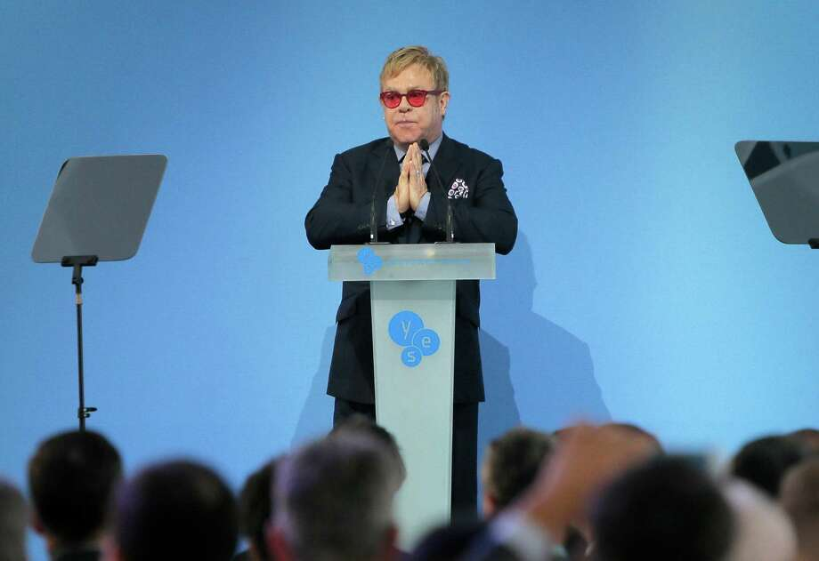 """Sir Elton John speaking  during the 12th  Annual Meeting entitled """"At Risk: How New Ukraine's Fate Affects Europe and the World"""" organized by the Yalta European Strategy (YES) in partnership with the Victor Pinchuk Foundation at the Mystetsky Arsenal Art Center in Kiev, Ukraine, Saturday, Sept. 12, 2015. Sir Elton John delivered a keynote speech  about the role of business in promoting human rights.  More than 200 leaders from politics, business and society representing more than 20 countries will discuss major global challenges and their impact on Europe, Ukraine and the world. (AP Photo/Efrem Lukatsky) Photo: Efrem Lukatsky, STF / AP"""